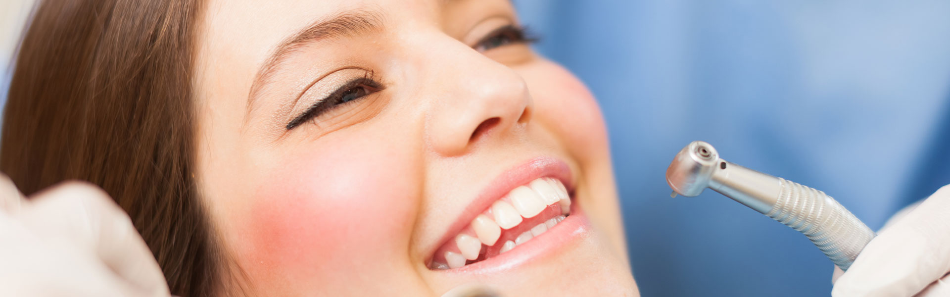 A woman is smiling at dental