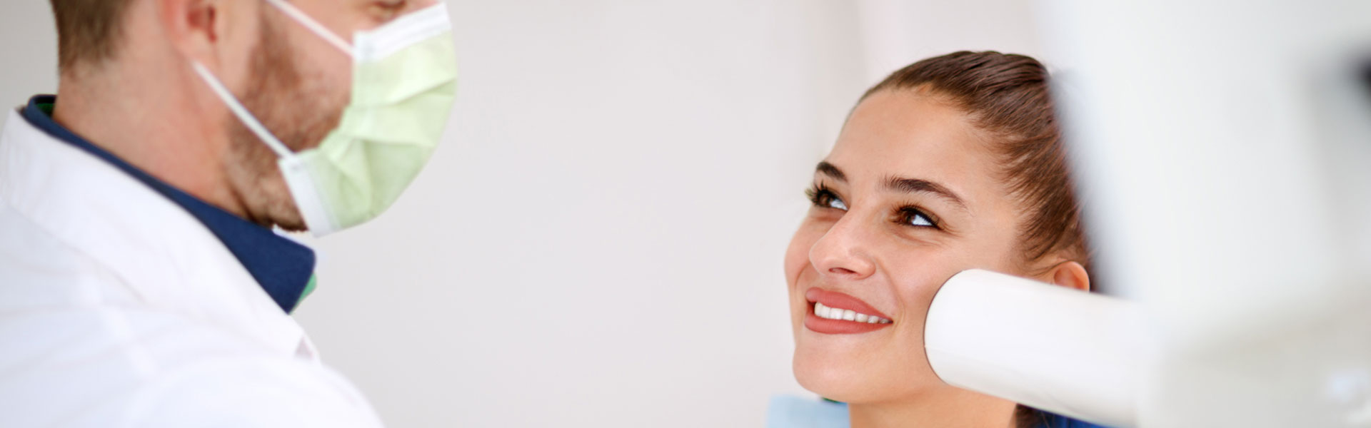 Woman is smiling at dental